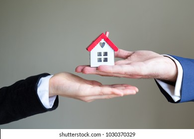 Real estate and mortgage investment. House on the hand.