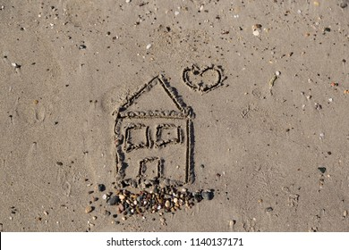 real estate and mortgage investment . house drawn on sand