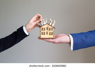 real estate and mortgage investment.the man holds the house.