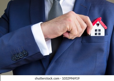 real estate and mortgage investment.the man puts the house in the pocket.