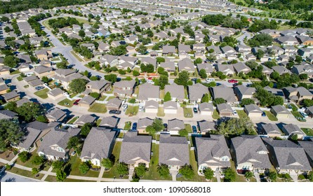 Real Estate New Development aerial drone view never ending rows of homes and houses square cookie cutter suburb suburbia neighborhood North of Austin in Round Rock , Texas , USA drone view