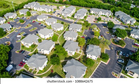 Real estate new development houses aerial drone view looking down from above square cookie cutter homes