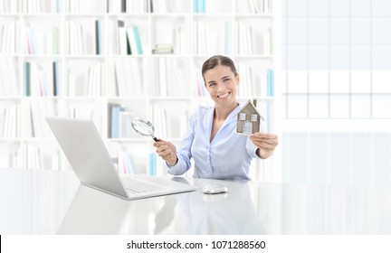 real estate office, smiling woman agent working on computer with magnifying glass, search home concept