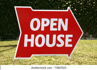 Real Estate Open House sign in a yard outside