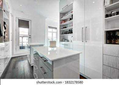 Real estate photography - Kitchen, bathrooms and rooms of the interior of the Big Luxury staged and furnished house in Montreal with swimming pool, BBQ and backyard