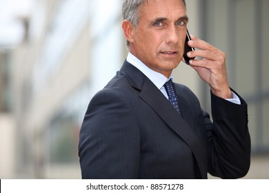 Real estate promoter on phone