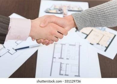 Real estate property deal handshake