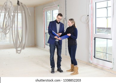 A Real estate purchase with broker or architect and woman