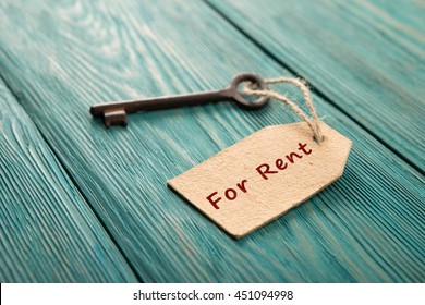 real estate rent concept - old key with tag