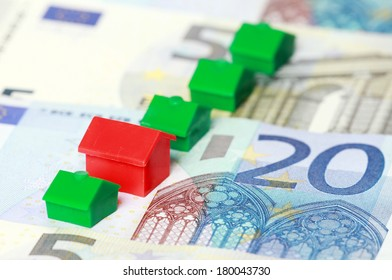 Real estate replica houses on euro banknotes