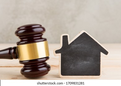 Real estate sale auction concept - gavel and house model