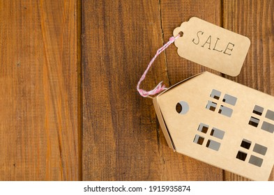 Real estate sale concept, paper model of residential building. Studio Photo