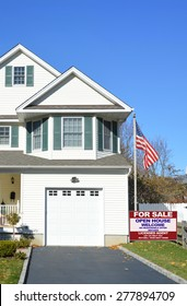 Real estate for sale open house welcome sign American flag pole Suburban Home Garage Windows residential neighborhood USA Clear Blue sky