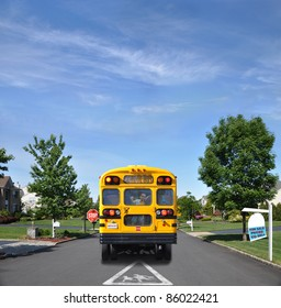 Real Estate For Sale Sign on Lawn and Children Crossing Traffic Sign on Suburban Residential Neighborhood Street with School Bus and Child Inside on Sunny Blue Sky Day