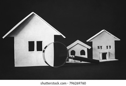 real estate searching, (magnifying glass with houses)