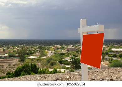 Real Estate Sign on a Mountain View Land Parcel Lot