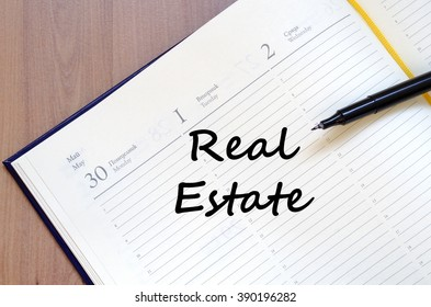 Real estate text concept write on notebook with pen