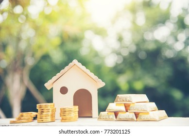 Real estate valuation Saving Money Concept. Woman hand go down on budget to buy house real estate agent. Gold coins stack symbol buy house