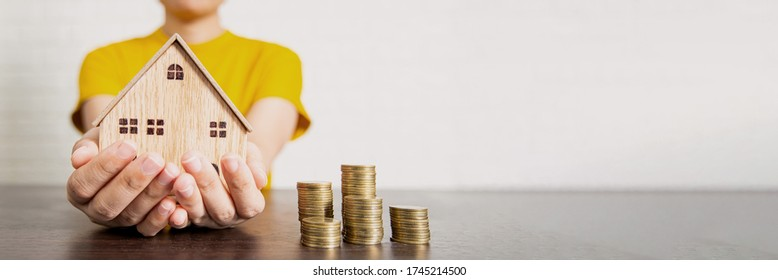real estate, woman holding house and money on table, bet offer and low interest concept