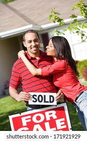 Real Estate: Woman Hugs Man After Buying Home