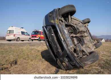 Real event. Car accident. The car crashed on the road and overturned. Car accident over raining day in autumn time.