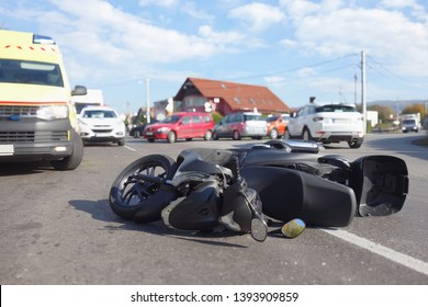 Real event, Motorcycle accident, crash at sunny day. Motorcycle crash concept. Emergency and ambulance help motorcycle rider.