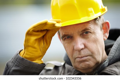 real experienced builder with yellow hardhat, natural light