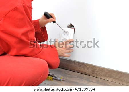 Real female electrician fixing
