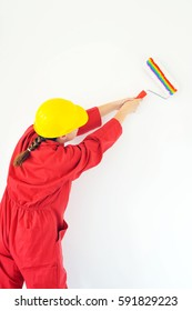 Real female painting wall, home renovation concept