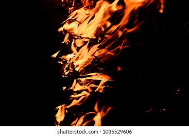 Real fires of trash isolated yellowish abstract background photograph