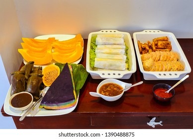 Real Food - Philippine dessert/snack, fresh rolls, papaya, rice cake, fried rools, 'suman', etc.
