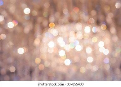Real golden bokeh from crystal chandelier as abstract background