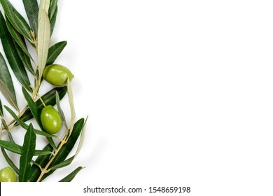 Real green olives and leaves background, with white surface for copy space and mock up.