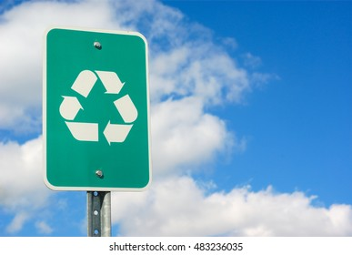 real green recycle panel board sign on cloudy sky