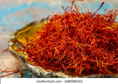 Real iranian red dried saffron spice close up