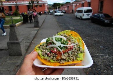 Real Latin American Tostada with Onion, Meat, Salsa, Tomato / Latin American Food