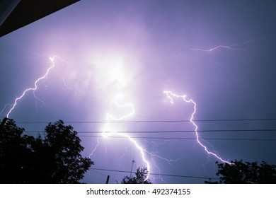 Real Lightning Bolt In City During A Storm Seen From House Window