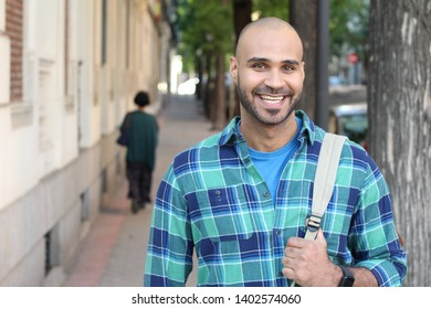 Real looking ethnic man smiling outdoors