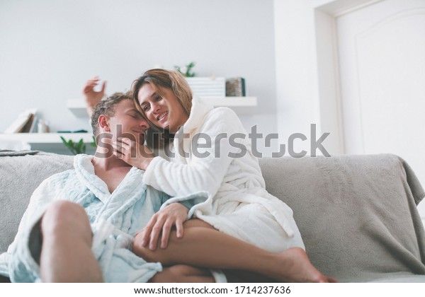 Real love. Beautiful young couple bonding and smiling while sitting in the bedroom. Smile woman. Couple in love. People. Celebration. Home concept. New day. Idea. Photo. Crazy. Romantic. House. Life
