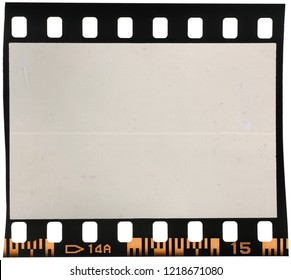 Real macro photo of 35mm dia film frame or strip on white with signs of usage, dust and film grain
