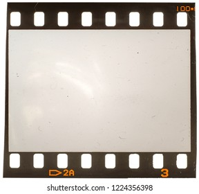 Real macro photo of 35mm dia filmstrip on white, placeholder for your image