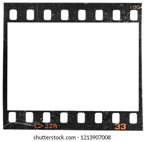 Real macro photo of 35mm film frame or dia strip on white with signs of usage, dust or dirt