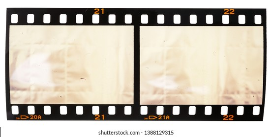 real macro photo of 35mm film snip with two empty frames or cells on white background, just blend in your photos here to get that old film effect