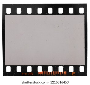 Real macro photo of old 35mm film strip or dia frame with signs of usage and dust and grain, just blend in your own content to make it look old and retro