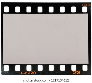 real macro photo of old 35mm dia film strip on white with signs of usage, dust and grain on it, just blend in your own picture to make it look vintage or retro, no scan