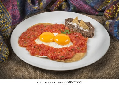"""Real Mexican Huevos Rancheros Classic Mexican breakfast surrounded by a traditional """"zarape"""" that is a very colorful shawl"""