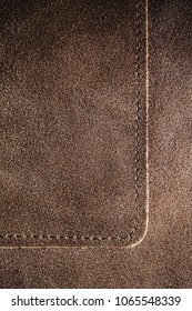 Real natural brown leather texture with stitching.