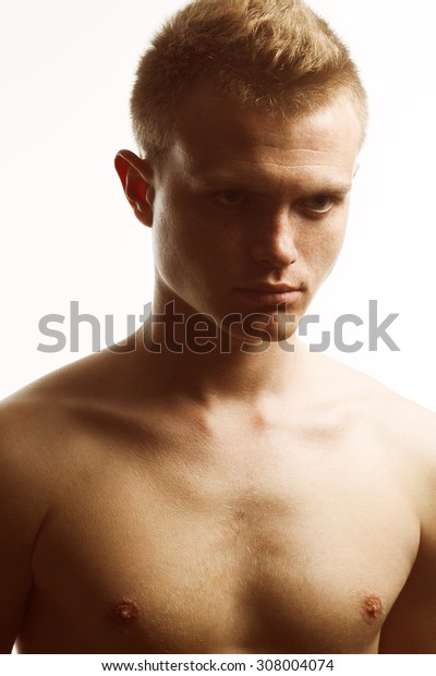 Real natural male beauty concept. Close up portrait of handsome charismatic young man posing over white background. Trendy hipster haircut. Classic style photo. Fashion studio shot