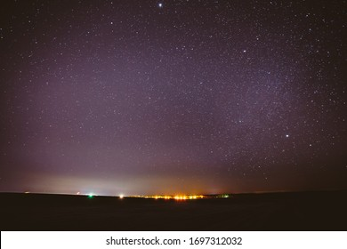 Real Night Sky Stars Background With Natural Colourful Sky Gradient. Sunset, Sunrise Light And Starry Sky Over Horizon.