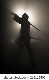 A real ninja shot on a smoke filled room and strobe light to achieve a dramatic effect.
